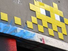 Invader piece half picked over by a scavenger
