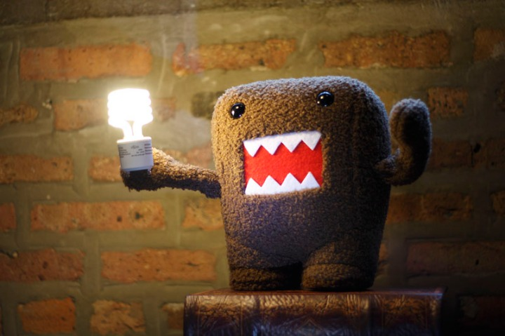 stuffed creature holding lightbulb