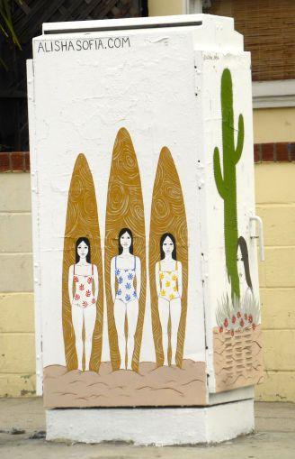 three women with surfboards street art