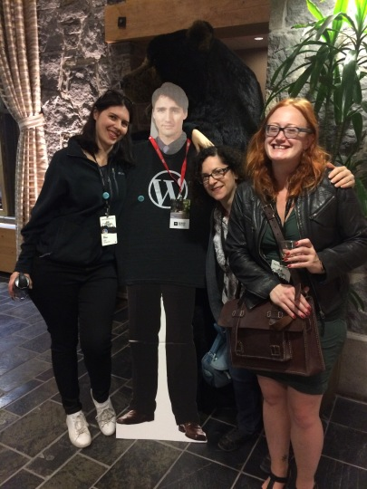 Me and 2 colleagues with a cardboard cutout of Justin Trudeau and a bear in the background
