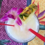 fruity drink with flower and pineapple