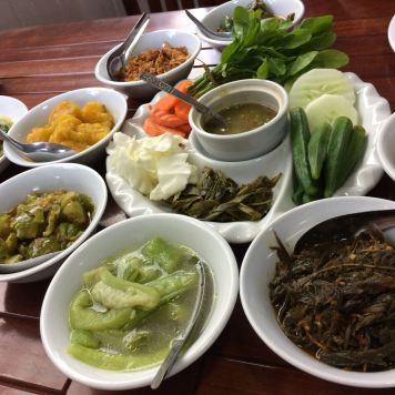 small plates of vegetables with dipping sauce