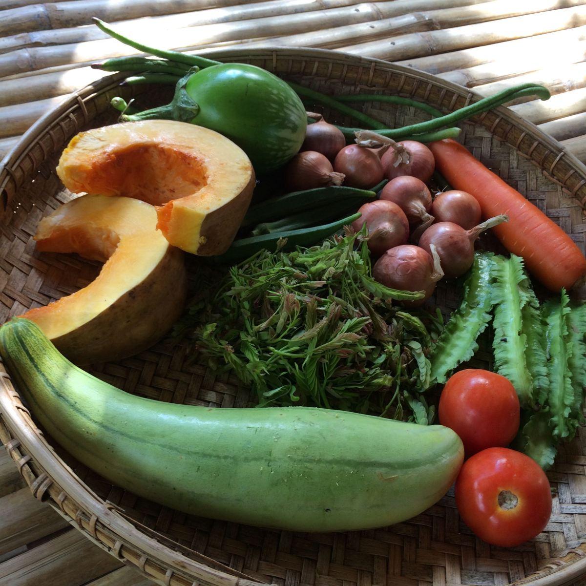 fresh vegetables in wood basket