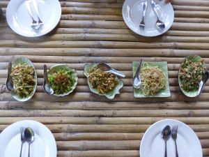 finished food laid out on table with plates and cutlery