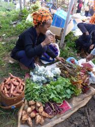 woman selling vegetables