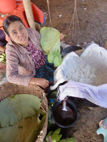 woman showing rice