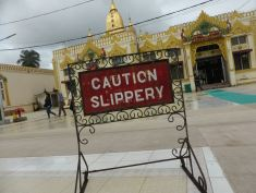 Caution slippery (sign at pagoda)
