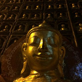 low-angle golden Buddhas
