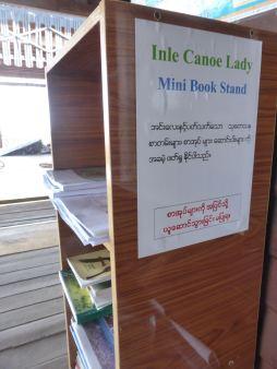 bookcase with sign: Inle Canoe Lady Mini Book Shelf