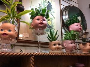 creepy dollhead planters