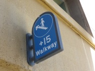 +15 walkway with icon of person wearing cowboy hat