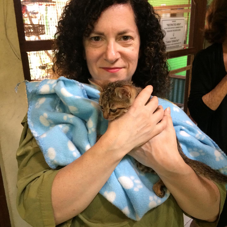 Me cuddling a kitten