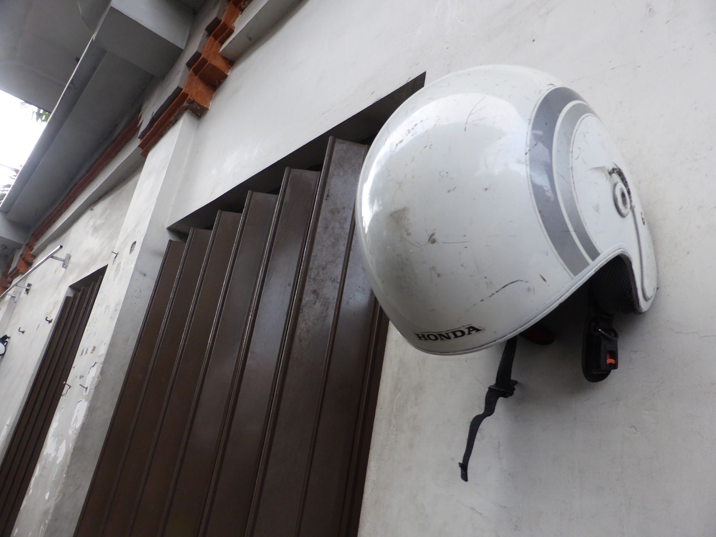scooter helmet hanging on wall