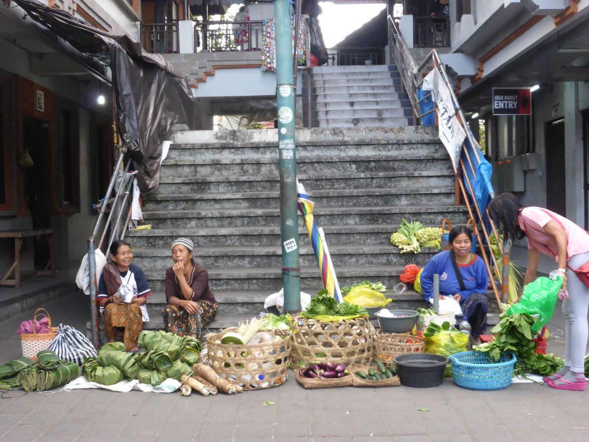 sellers sitting at bottom of concrete stairs