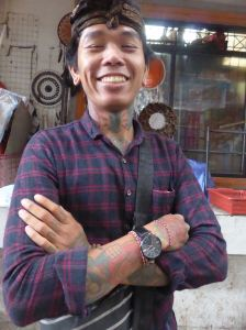 smiling man with tattoos