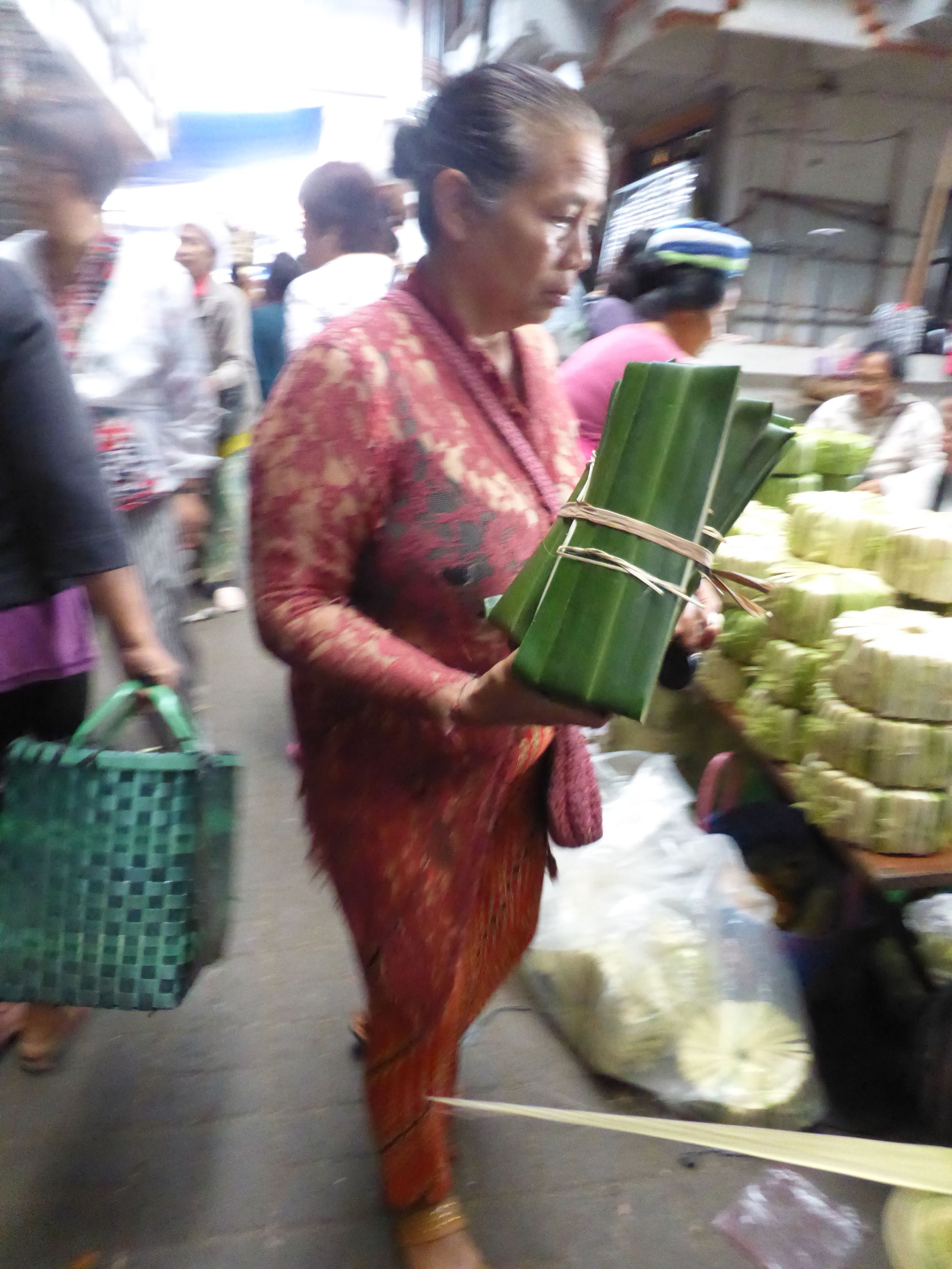 woman with packet of leaves
