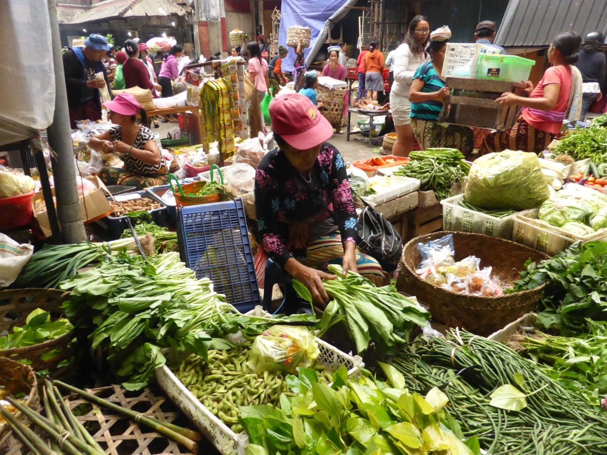 seller surrounded by produce