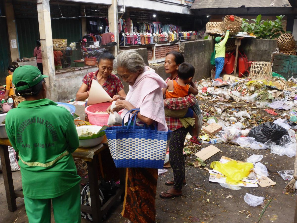 tranaction in front of garbage pile
