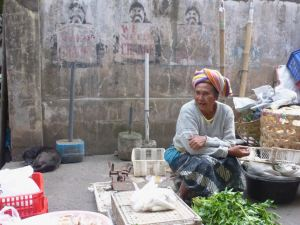 seller smiling in front of concrete wall