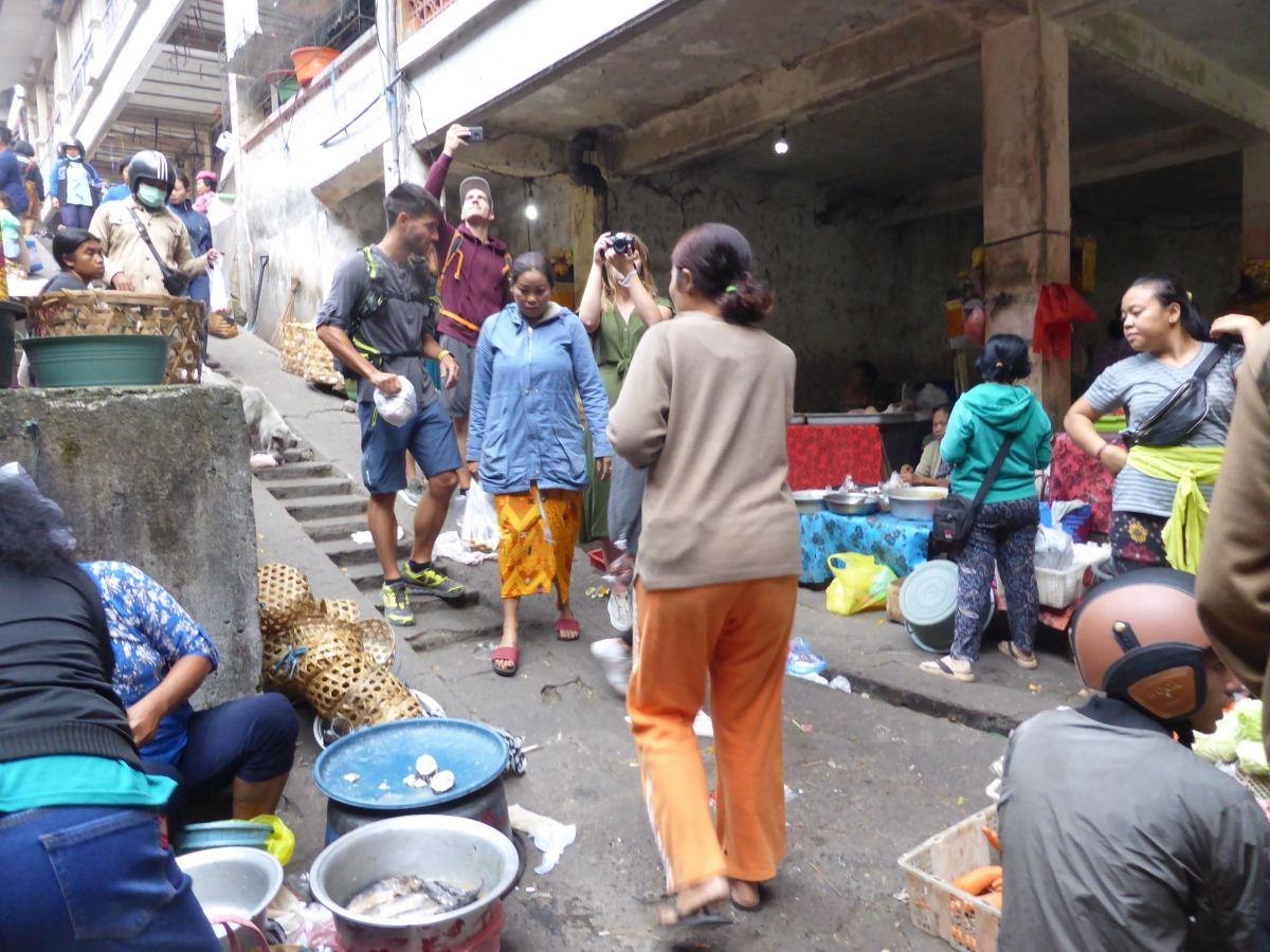 tourists taking photos at market