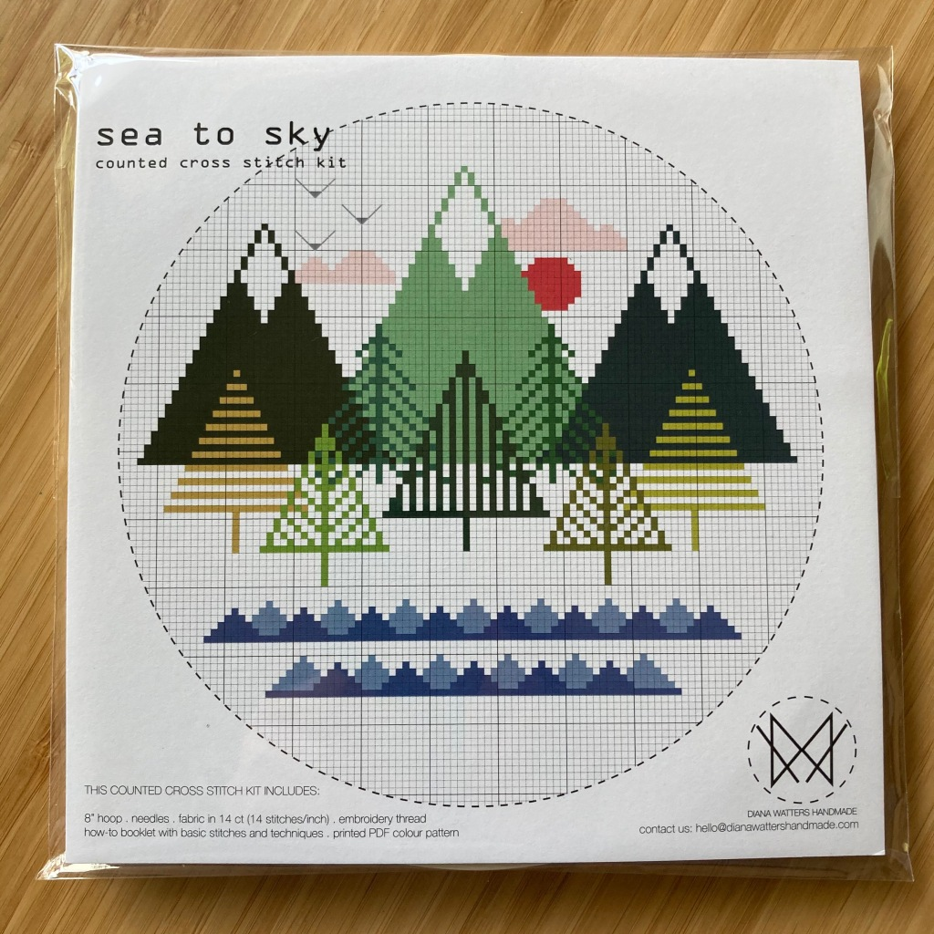 Sea to sky cross-stitch kit. Trees and ocean abstract design in a circle.